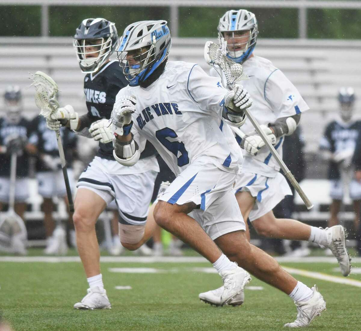 Darien's Connor O'Malley (6) breaks out of the defensive zone with the ball against Staples during the FCIAC final Friday.