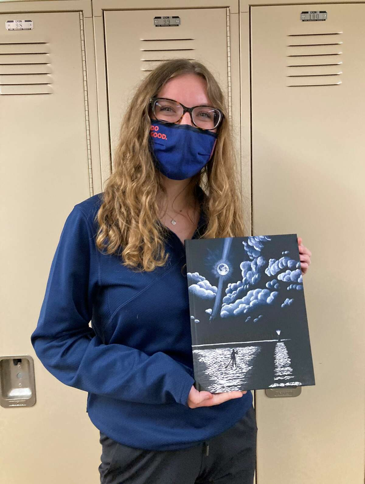 Frankfort High School yearbook editor Sydney Miller holds the completed 2021 yearbook, which carries the theme