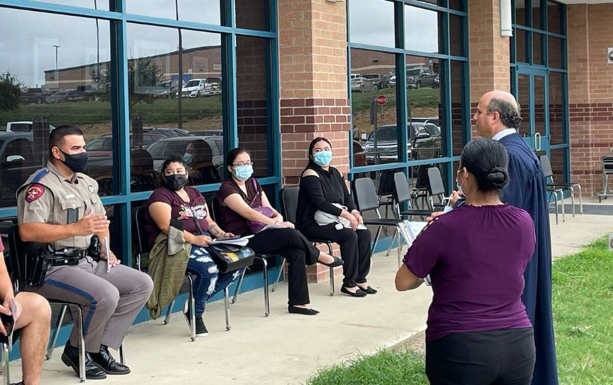 406th District Court Judge Oscar J. Hale held curbside and walk up juror qualifications at the Student Activity Center.