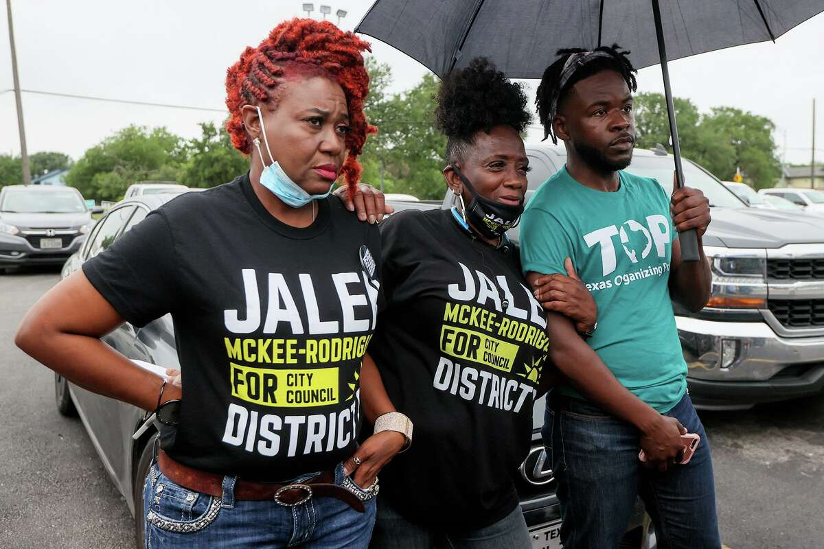 Jalen McKee-Rodriguez supporters Le Reta Gatlin McDavid, from left, Joy Blake and Rodney Brown, listen to others speak about McKee-Rodriguez, who is running against Councilwoman Jada Andrews-Sullivan in the upcoming District 2 runoff, outside the Claude Black Center at 2805 E. Commerce St. on Friday.