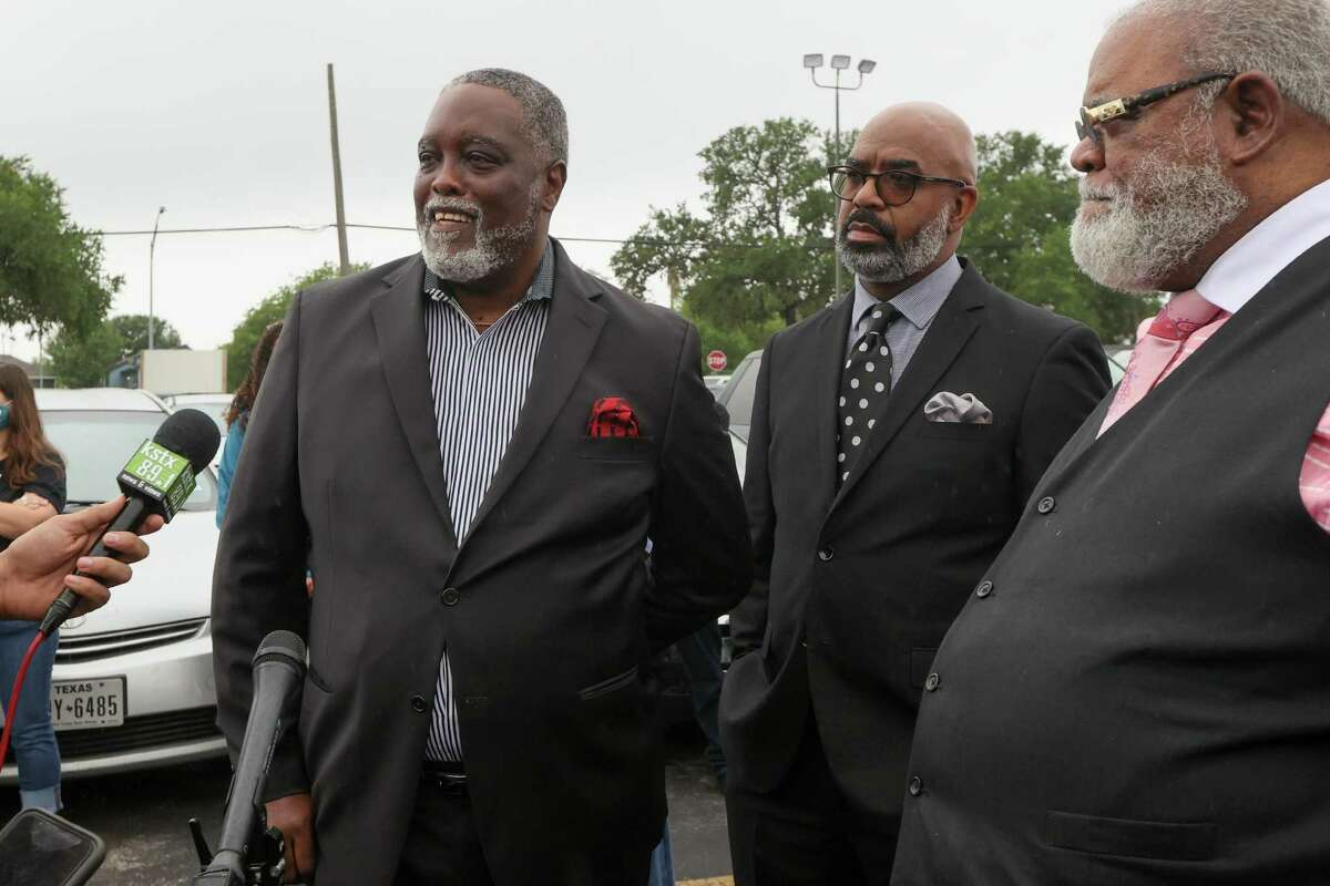 Rev. Patrick Jones, left, of Greater Pilgrim Rest Baptist Church and president of the Baptist Ministers Union, speaks in support of District 2 Councilwoman Jada Andrews-Sullivan outside the Claude Black Center at 2805 E. Commerce St. on Friday.