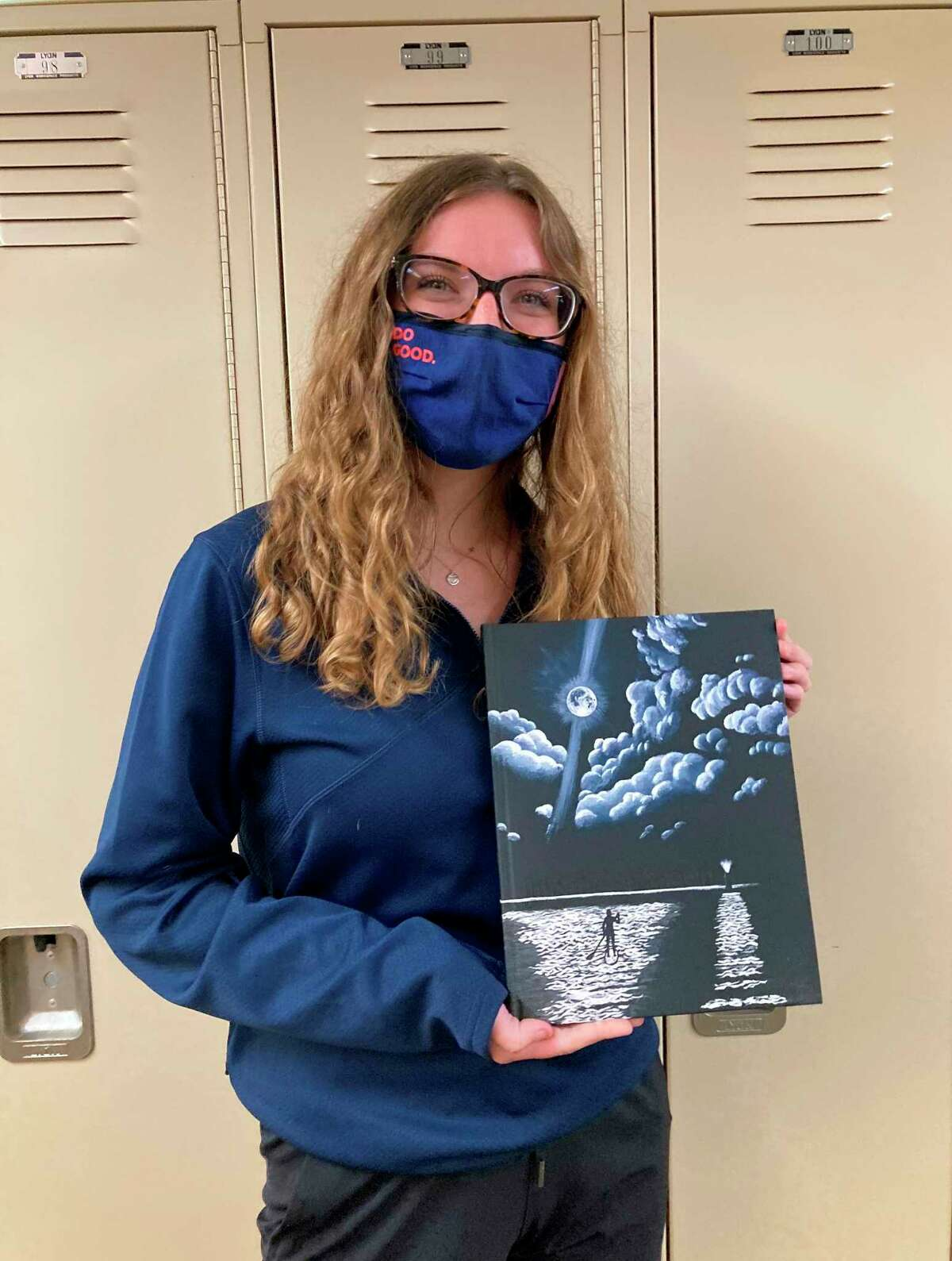Frankfort High Schoolyearbook editor Sydney Millerholds the completed 2021 yearbook, which carries the theme