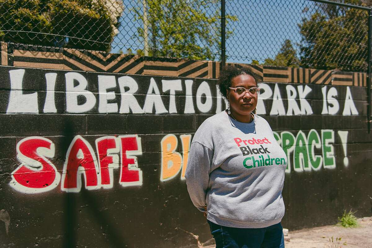 Ndidi Okwelogu, the economic development manager for Black Cultural Zone, poses for a portrait at Liberation Park in Oakland. Once a vacant lot used for illegal dumping, Black Cultural Zone has transformed Liberation Park into a community gathering place and monthly outdoor market.