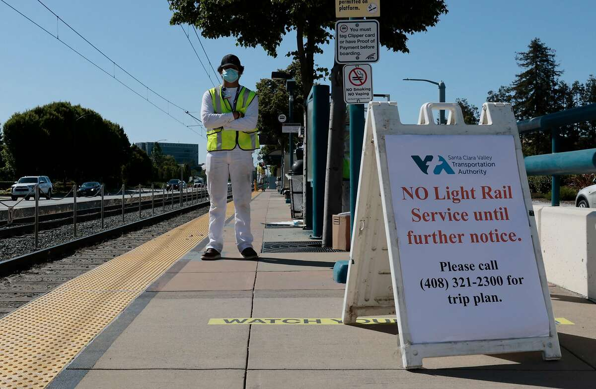 VTA painter contractor Scott Armstrong stands near the signage posted