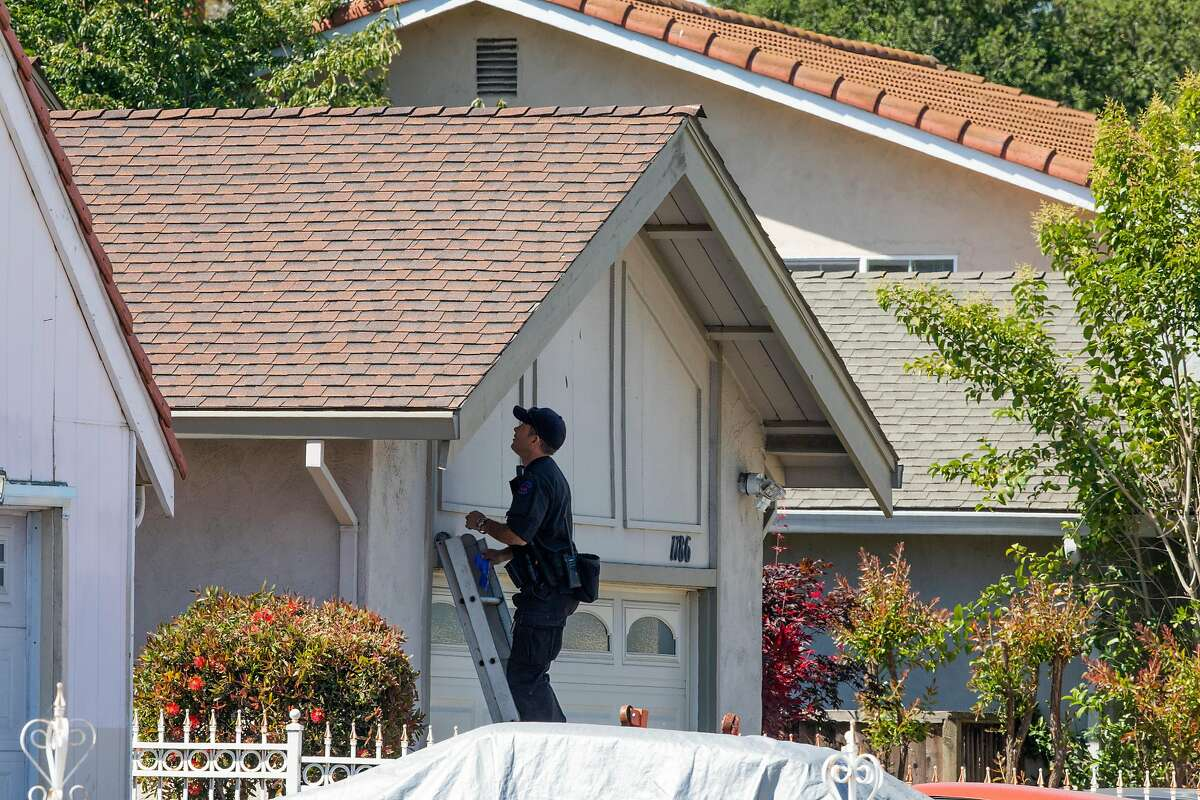San Jose bomb squad investigate next to the home Samuel James Cassidy, Thursday, May 27, 2021, in San Jose, Calif. A shooting on Wednesday at the Valley Transportation Authority light-rail yard left 10 people dead, including Cassidy, a VTA employee who is the suspected shooter.