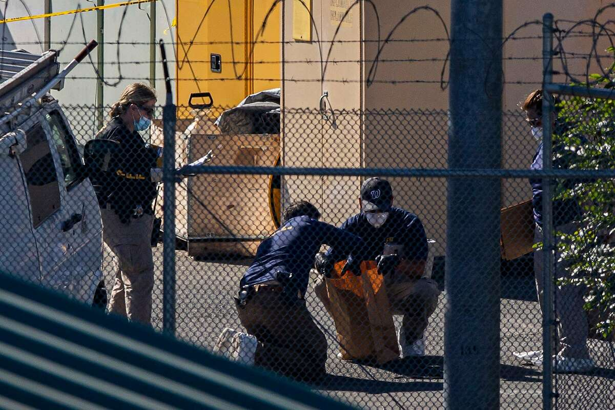 The FBI collects evidence at the Valley Transportation Authority light-rail facility yard in San Jose on Wednesday.