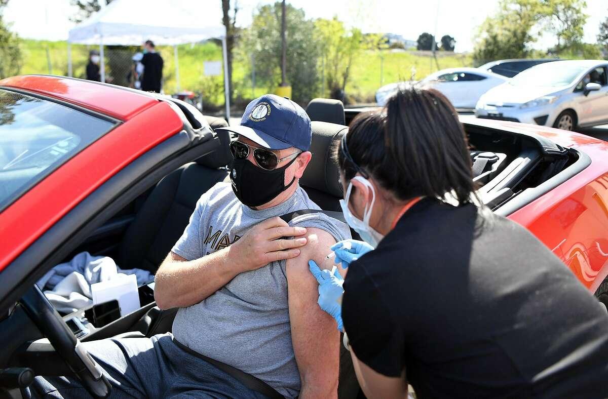 Drake Gardener receives a vaccination in Novato in March.