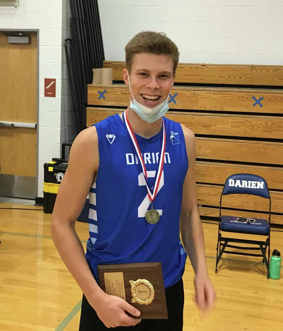 Darien's Tim Herget earned the Most Valuable Player Award in the FCIAC boys' volleyball tournament.