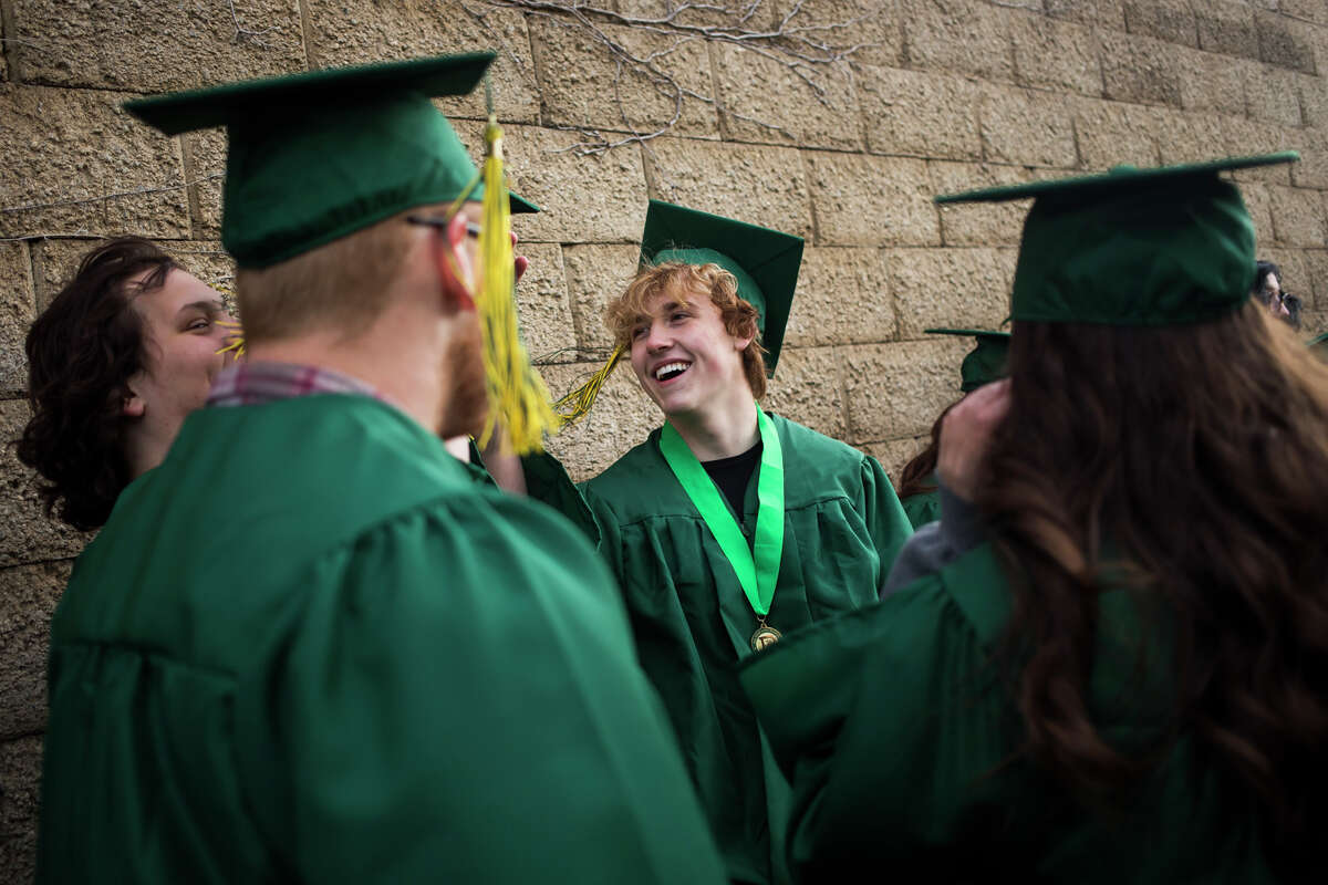 Colton Boguszewski laughs with friends before the H. H. Dow High School Class of 2021 commencement ceremony Friday, May 28, 2021 at Dow Diamond in Midland. (Katy Kildee/kkildee@mdn.net)
