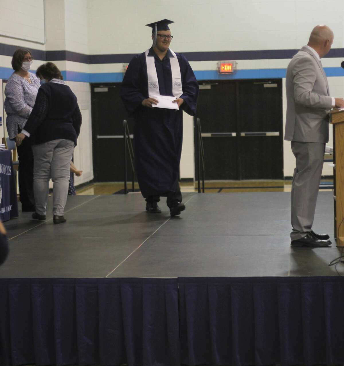 Brethren graduate Anthony Beccaria walks across the stage during a commencement ceremony Friday night.