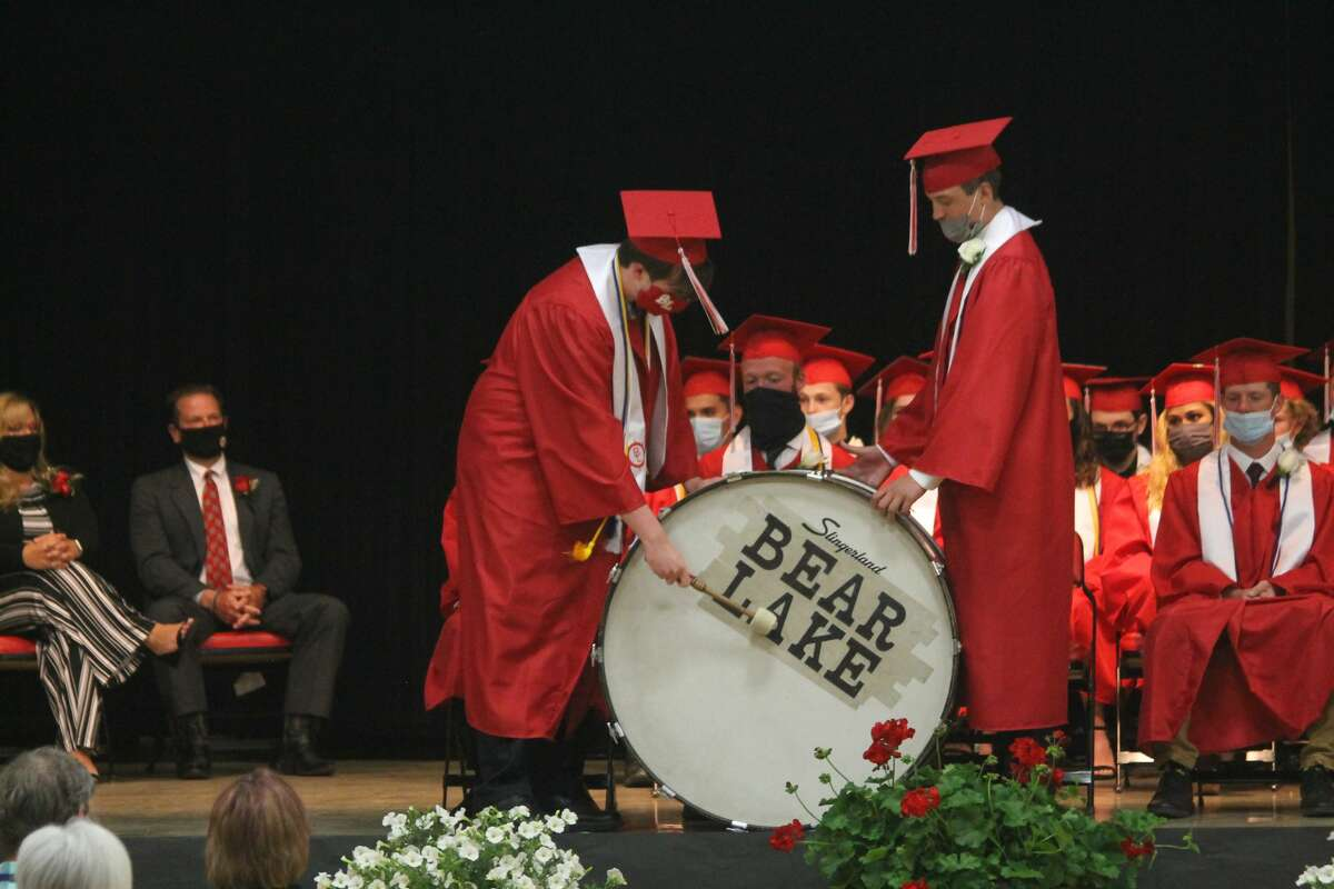 Edward Fairchild and Brendan Bucker beat the senior drum during a commencement ceremony during Bear Lake High School's commencement ceremony on Friday.