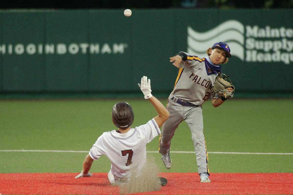 Jersey Village's Donavin Crisostomo (2) throws for the double play as Pearland's Cain Landry (7) slides into second base Friday, May 28 at the University of Houston.