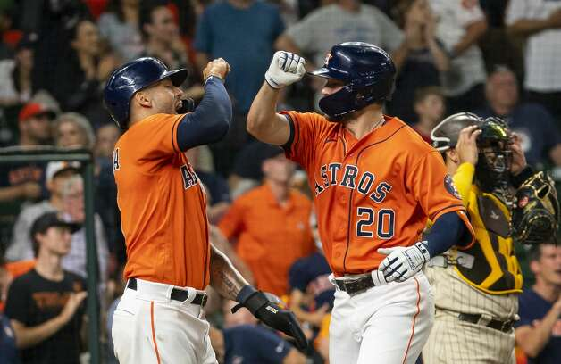 Houston Astros right fielder Chas McCormick (20) celebrates with Houston Astros shortstop Carlos Correa (1) after hitting a two-run home run during the fourth inning of an MLB game between the Houston Astros and San Diego Padres on Friday, May 28, 2021, at Minute Maid Park in Houston. Photo: Mark Mulligan/Staff Photographer / © 2021 Mark Mulligan / Houston Chronicle