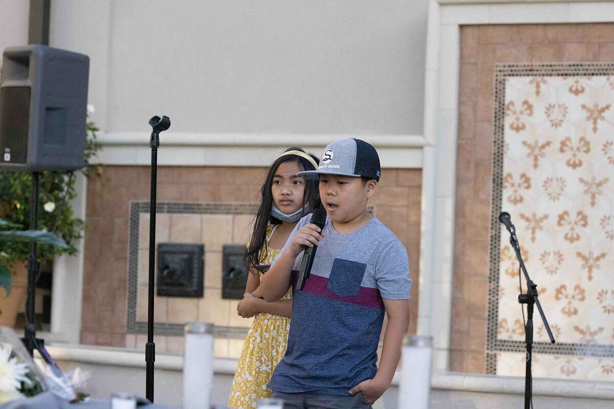 Paul Megia's stepson, Kyle, and his daughter Avery speak at their dad vigil on Friday, May 28, 2021 in Mountain House, Calif.