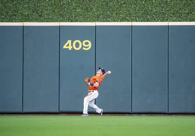 Houston Astros center fielder Myles Straw (3) throws back a long fly ball by San Diego Padres left fielder Tommy Pham (28) during the seventh inning of an MLB game between the Houston Astros and San Diego Padres on Friday, May 28, 2021, at Minute Maid Park in Houston. Photo: Mark Mulligan/Staff Photographer / © 2021 Mark Mulligan / Houston Chronicle