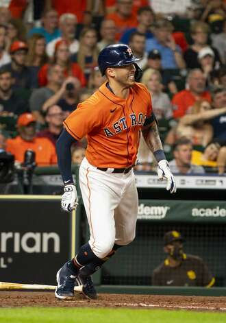 Houston Astros shortstop Carlos Correa (1) singles during the first inning of an MLB game between the Houston Astros and San Diego Padres on Friday, May 28, 2021, at Minute Maid Park in Houston. Photo: Mark Mulligan/Staff Photographer / © 2021 Mark Mulligan / Houston Chronicle
