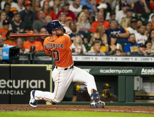 Houston Astros right fielder Chas McCormick (20) hits a two-run home run during the fourth inning of an MLB game between the Houston Astros and San Diego Padres on Friday, May 28, 2021, at Minute Maid Park in Houston. Photo: Mark Mulligan/Staff Photographer / © 2021 Mark Mulligan / Houston Chronicle