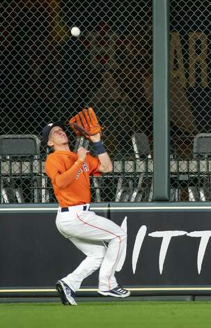 Houston Astros center fielder Myles Straw (3) catches a fly ball during the fifth inning of an MLB game between the Houston Astros and San Diego Padres on Friday, May 28, 2021, at Minute Maid Park in Houston. Photo: Mark Mulligan/Staff Photographer / © 2021 Mark Mulligan / Houston Chronicle