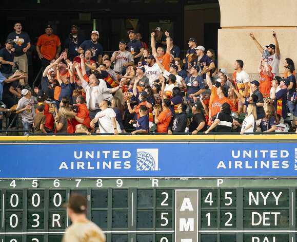 Fans react as they catch a home run by Houston Astros right fielder Chas McCormick (20) during the fourth inning of an MLB game between the Houston Astros and San Diego Padres on Friday, May 28, 2021, at Minute Maid Park in Houston. Photo: Mark Mulligan/Staff Photographer / © 2021 Mark Mulligan / Houston Chronicle