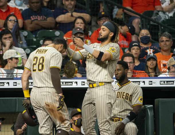 San Diego Padres shortstop Fernando Tatis Jr. (23) welcomes San Diego Padres left fielder Tommy Pham (28) back to the dugout after Pham hit a home run during the third inning of an MLB game between the Houston Astros and San Diego Padres on Friday, May 28, 2021, at Minute Maid Park in Houston. Photo: Mark Mulligan/Staff Photographer / © 2021 Mark Mulligan / Houston Chronicle