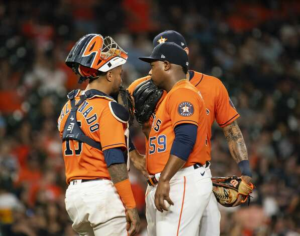 Houston Astros catcher Martin Maldonado (15) and Houston Astros starting pitcher Framber Valdez (59) talk on the mound during the third inning of an MLB game between the Houston Astros and San Diego Padres on Friday, May 28, 2021, at Minute Maid Park in Houston. Photo: Mark Mulligan/Staff Photographer / © 2021 Mark Mulligan / Houston Chronicle