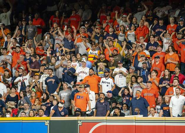 Fans watch a double by Houston Astros left fielder Kyle Tucker (30) during the third inning of an MLB game between the Houston Astros and San Diego Padres on Friday, May 28, 2021, at Minute Maid Park in Houston. Photo: Mark Mulligan/Staff Photographer / © 2021 Mark Mulligan / Houston Chronicle