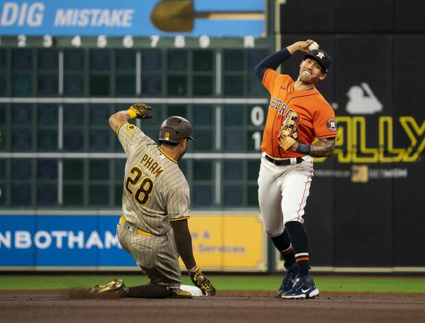 Houston Astros shortstop Carlos Correa (1) throws to first after getting San Diego Padres left fielder Tommy Pham (28) out at second during the first inning of an MLB game between the Houston Astros and San Diego Padres on Friday, May 28, 2021, at Minute Maid Park in Houston. Photo: Mark Mulligan/Staff Photographer / © 2021 Mark Mulligan / Houston Chronicle
