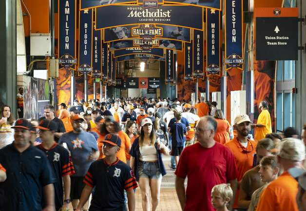 Fans walk through the concourse before an MLB game between the Houston Astros and San Diego Padres on Friday, May 28, 2021, at Minute Maid Park in Houston. Photo: Mark Mulligan/Staff Photographer / © 2021 Mark Mulligan / Houston Chronicle