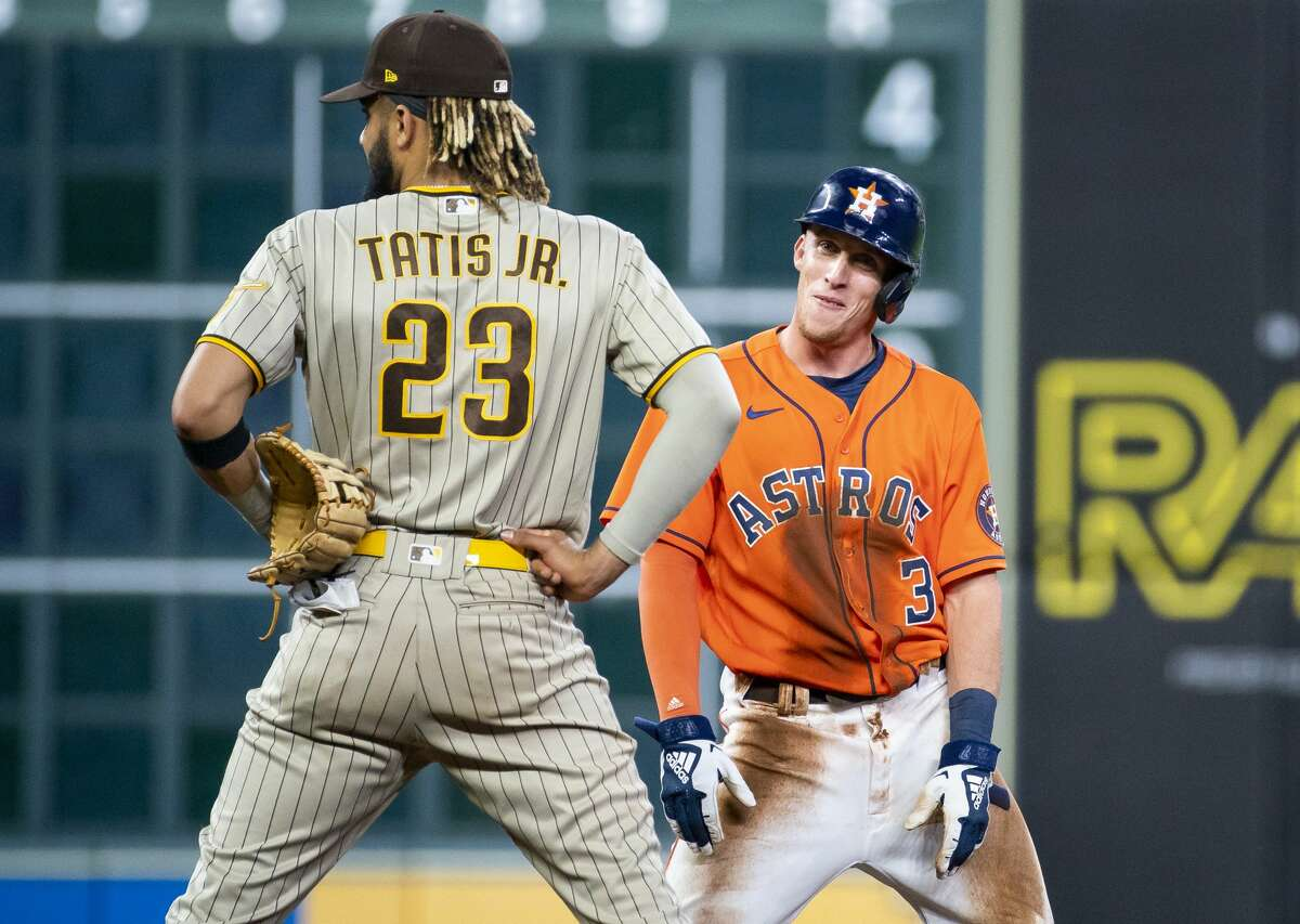 Houston Astros center fielder Myles Straw (3) and San Diego Padres shortstop Fernando Tatis Jr. (23) watch a replay of Straw getting caught stealing at second during the sixth inning of an MLB game between the Houston Astros and San Diego Padres on Friday, May 28, 2021, at Minute Maid Park in Houston. The out call was not overturned after review.