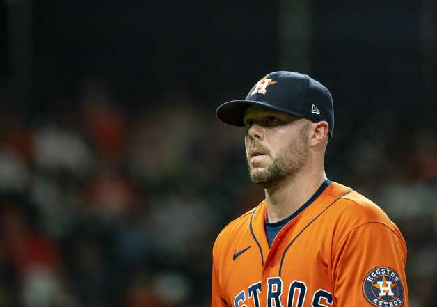 Houston Astros relief pitcher Ryan Pressly (55) walks back to the dugout after a 1-2-3 ninth inning during an MLB game between the Houston Astros and San Diego Padres on Friday, May 28, 2021, at Minute Maid Park in Houston. Photo: Mark Mulligan/Staff Photographer / © 2021 Mark Mulligan / Houston Chronicle