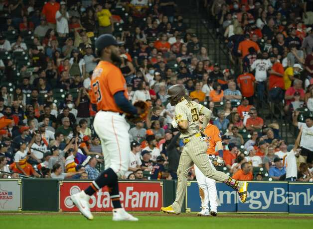 San Diego Padres shortstop Fernando Tatis Jr. (23) runs past Houston Astros relief pitcher Cristian Javier (53) after hitting a solo home run to tie the score 2-2 during the eighth inning of an MLB game between the Houston Astros and San Diego Padres on Friday, May 28, 2021, at Minute Maid Park in Houston. Photo: Mark Mulligan/Staff Photographer / © 2021 Mark Mulligan / Houston Chronicle