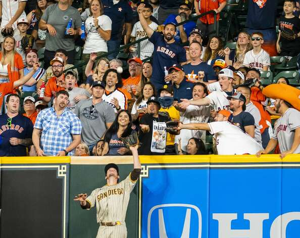 Fans watch as San Diego Padres right fielder Wil Myers (5) catches a fly ball from Houston Astros right fielder Chas McCormick (20) to end the seventh inning with two runners stranded during an MLB game between the Houston Astros and San Diego Padres on Friday, May 28, 2021, at Minute Maid Park in Houston. Photo: Mark Mulligan/Staff Photographer / © 2021 Mark Mulligan / Houston Chronicle