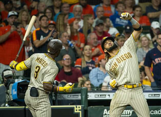 San Diego Padres shortstop Fernando Tatis Jr. (23) celebrates with San Diego Padres shortstop Jorge Mateo (3) after hitting a solo home run to tie the score 2-2 during the eighth inning of an MLB game between the Houston Astros and San Diego Padres on Friday, May 28, 2021, at Minute Maid Park in Houston. Photo: Mark Mulligan/Staff Photographer / © 2021 Mark Mulligan / Houston Chronicle