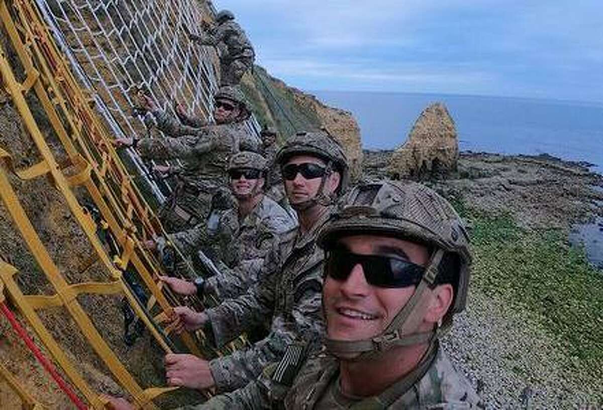 Pearce Cucchissi, front, scaled the cliffs at Pointe du Hoc in 2019 to commemorate the 75th anniversary of the D-Day landings in Normandy.