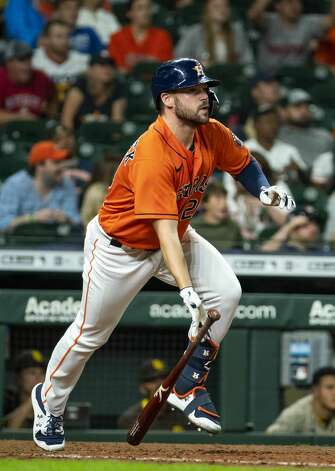 Houston Astros right fielder Chas McCormick (20) hits a sacrifice fly that scores Houston Astros third baseman Alex Bregman (2) to tie the game at 3-3 during the tenth inning of an MLB game between the Houston Astros and San Diego Padres on Friday, May 28, 2021, at Minute Maid Park in Houston. Photo: Mark Mulligan/Staff Photographer / © 2021 Mark Mulligan / Houston Chronicle