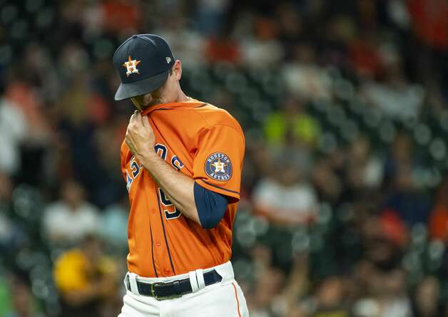 Houston Astros relief pitcher Brooks Raley (58) walks to the dugout after giving up two runs during the eleventh inning of an MLB game between the Houston Astros and San Diego Padres on Friday, May 28, 2021, at Minute Maid Park in Houston. Photo: Mark Mulligan/Staff Photographer / © 2021 Mark Mulligan / Houston Chronicle