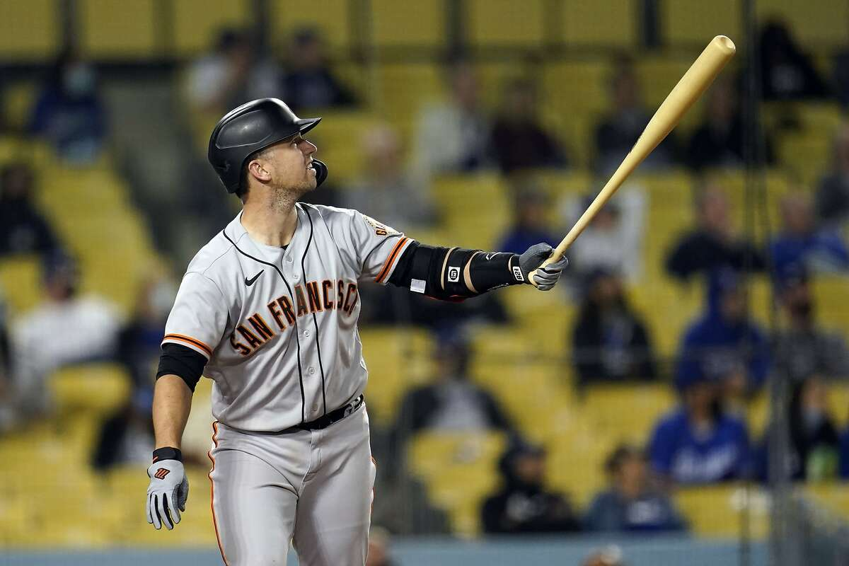 San Francisco Giants' Buster Posey follows through on his three-run home run during the eighth inning of a baseball game against the Los Angeles Dodgers Friday, May 28, 2021, in Los Angeles. (AP Photo/Marcio Jose Sanchez)
