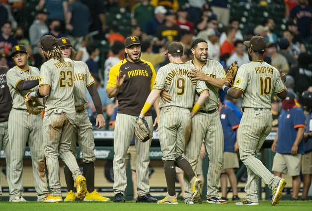 The Padres celebrate their 10-3, eleven inning win during an MLB game between the Houston Astros and San Diego Padres on Friday, May 28, 2021, at Minute Maid Park in Houston. Photo: Mark Mulligan/Staff Photographer / © 2021 Mark Mulligan / Houston Chronicle