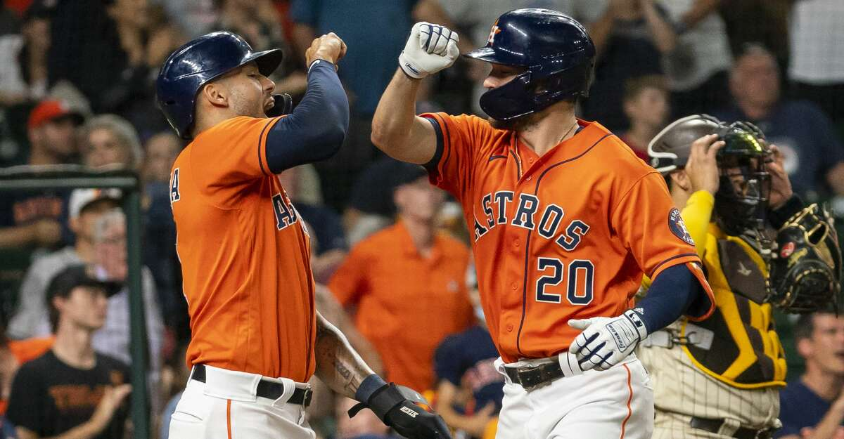 Houston Astros right fielder Chas McCormick (20) celebrates with Houston Astros shortstop Carlos Correa (1) after hitting a two-run home run during the fourth inning of an MLB game between the Houston Astros and San Diego Padres on Friday, May 28, 2021, at Minute Maid Park in Houston.
