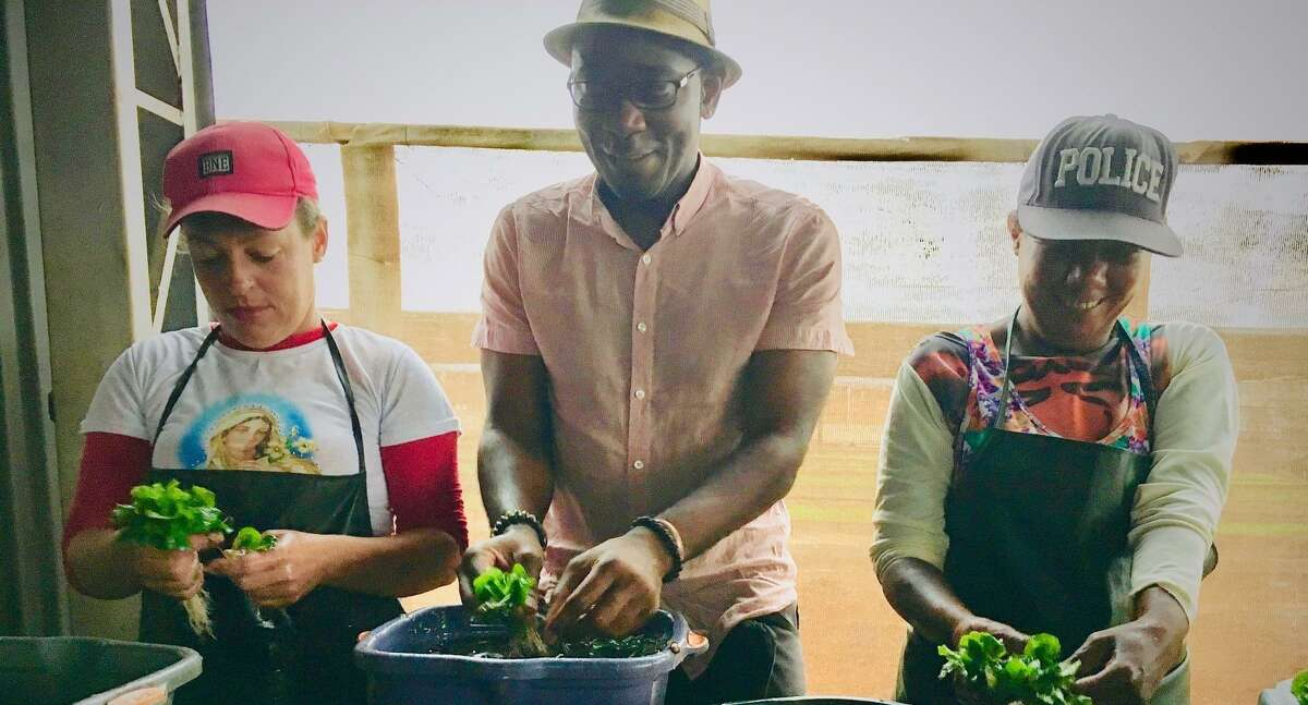 Co-owner Joel Castellanos spends some time with field workers replanting a coffee plant in Brazil in 2017. Castellanos and his wife Pascale Petronin celebrated their opening on Thursday with a ribbon cutting.