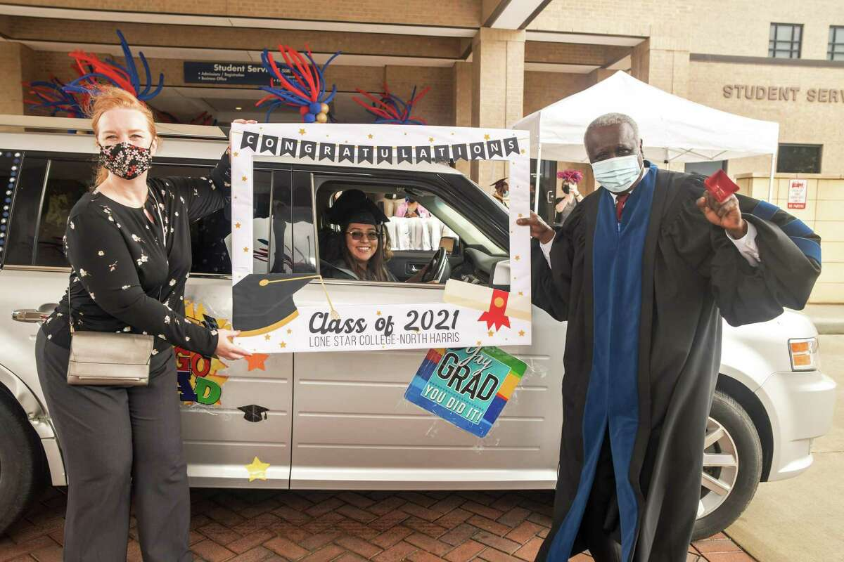 Students decorated their vehicles for the auspicious celebration. From left, Dr. Laura Yannuzzi, Vice President of Instruction, an LSC graduate, and Dr. Archie L. Blanson, president, LSC-North Harris.