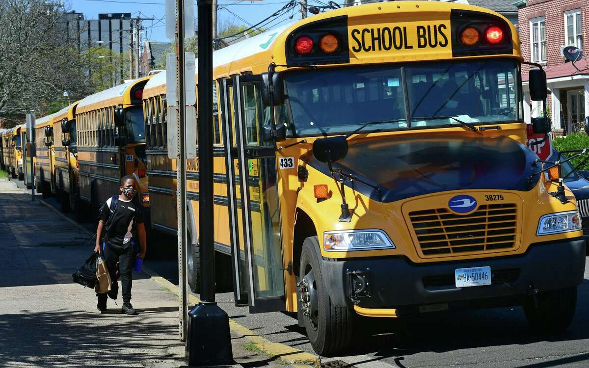 Buses lining up in front of Columbus Magnet School Friday afternoon,, April 23, ,2021, in Norwalk, Conn.