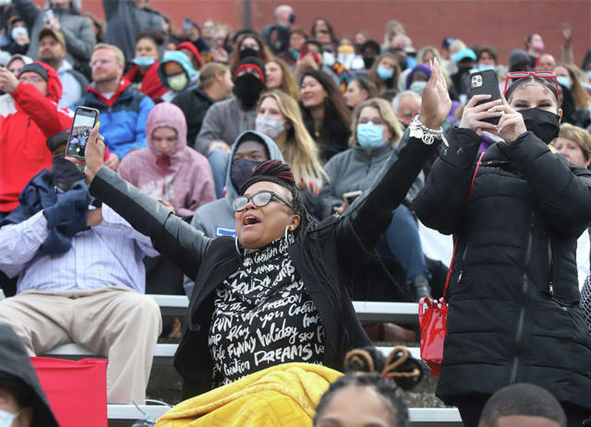 """From the bleachers at Public School Stadium, Candice L. Wallace shouts out, """"That's my baby,"""" as her daughter, Germayia Wallace, marches in the processional to the field for the first half of the 152nd Commencement of Alton High School. The other half of the class will graduate Saturday at 11 a.m. Students arrived and were assigned classrooms of no more than 10 students to await the lineup for the procession into the stadium. The 152nd graduating class underwent many challenges trying to finish school in the middle of a worldwide pandemic."""