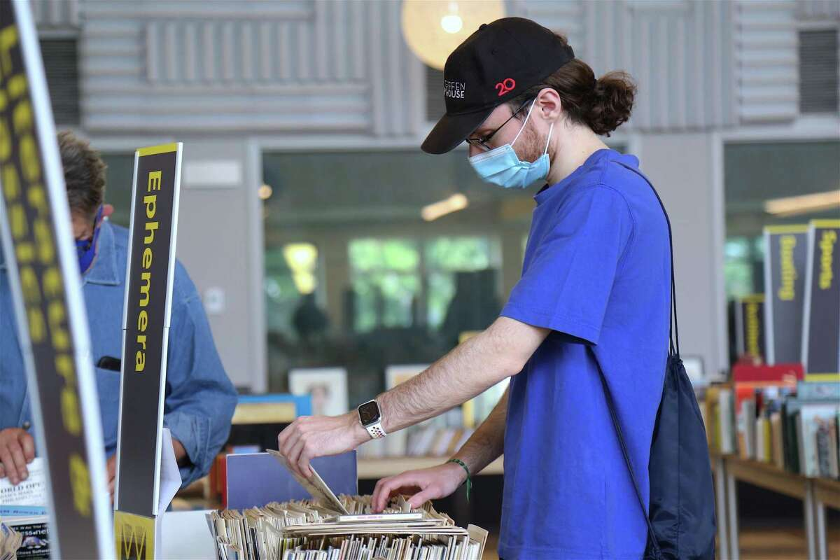 Evan Claman of Scarsdale, N.Y., looks through the selection at The Westport Library's Memorial Day Weekend Book Sale on Friday, May 28, 2021.