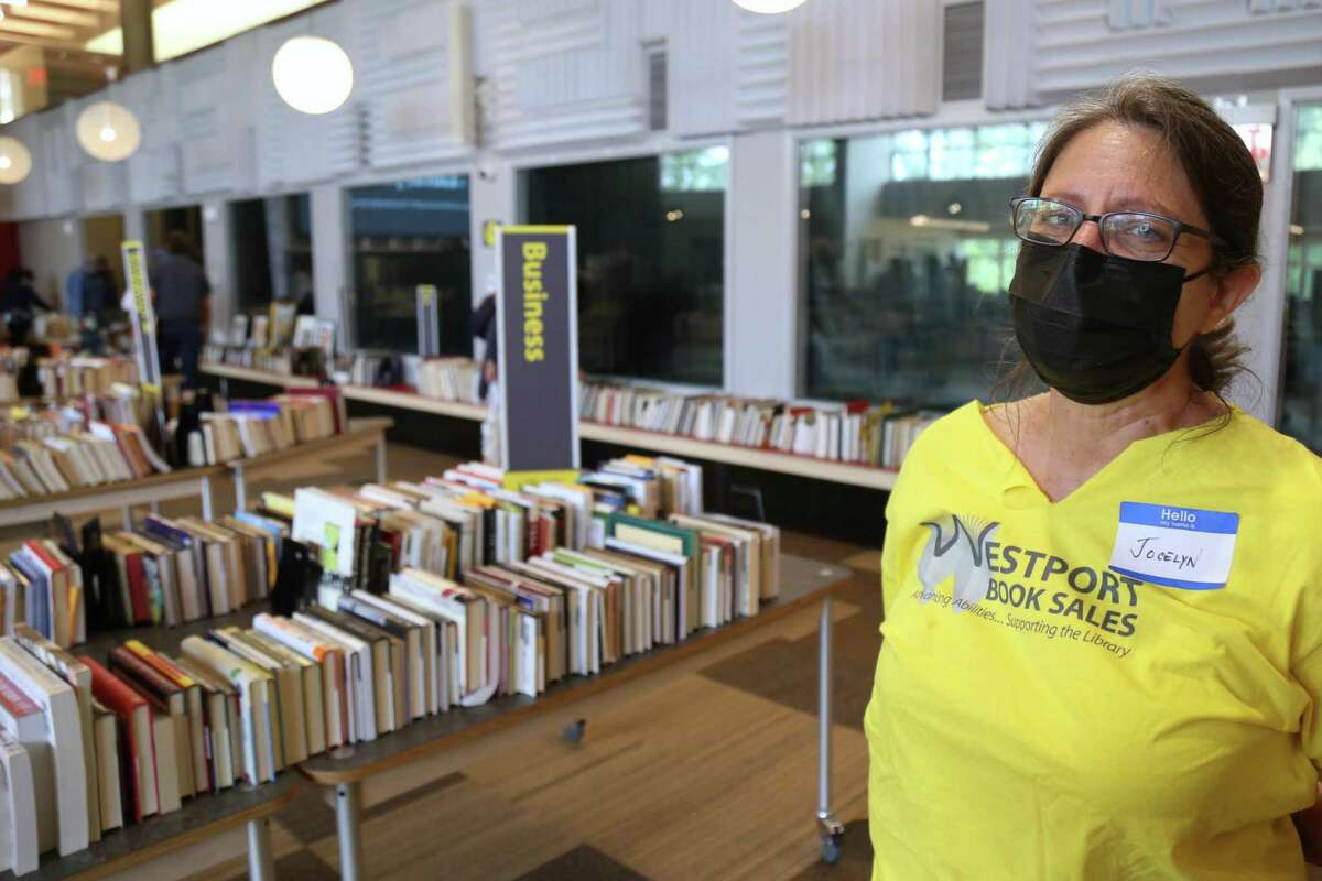 Jocelyn Barandiaran, president of the Westport Book Sale Vendors, welcomes people to The Westport Library's Memorial Day Weekend Book Sale on Friday, May 28, 2021.