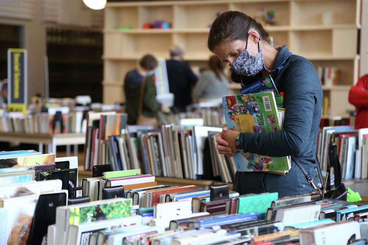 Katie Mchale of Fairfield looks through the books at The Westport Library's Memorial Day Weekend Book Sale on Friday, May 28, 2021.