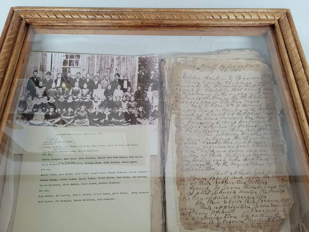 The original book of minutes from 1856 are on display in the church foyer along with a picture of students in front of the school that was also housed the church.
