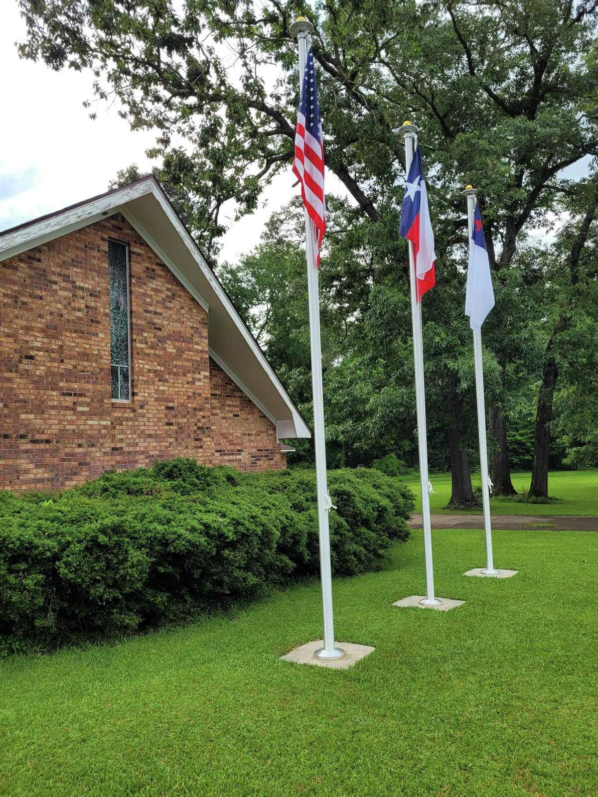The U.S., Texas and Christian flags are now permanently on display for all who drive by to see.
