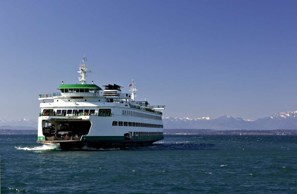 Ferry returning to port with Olympic Mountains on the horizon.