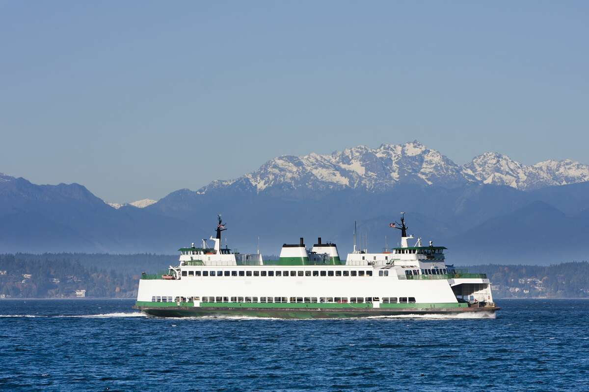 Washington State car and passenger ferry crossing Puget Sound. Olympic mountains in the background.
